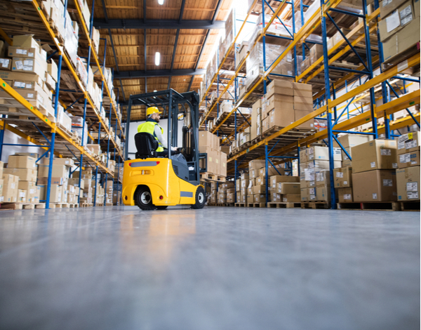 Warehouse man worker with forklift