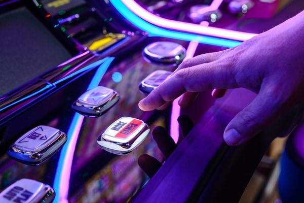 Male playing slot machine