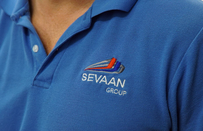 Man wearing a shirt with Sevaan Group logo