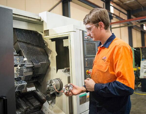 Man working using a machine inside a factory
