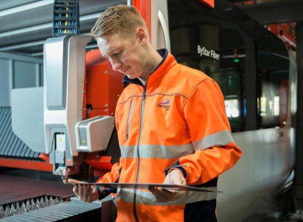 Man using machinery to drill