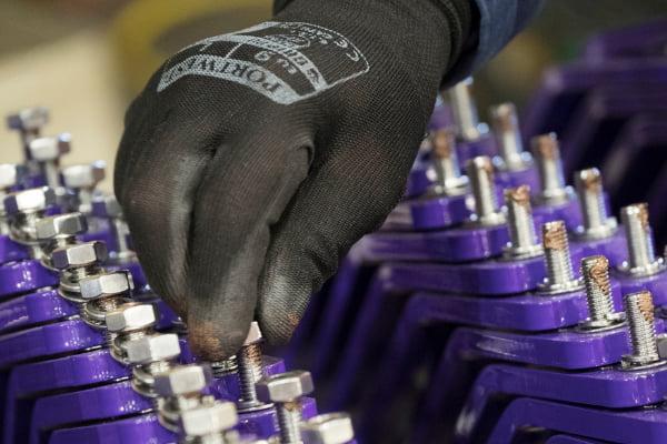 Man assembling metal parts