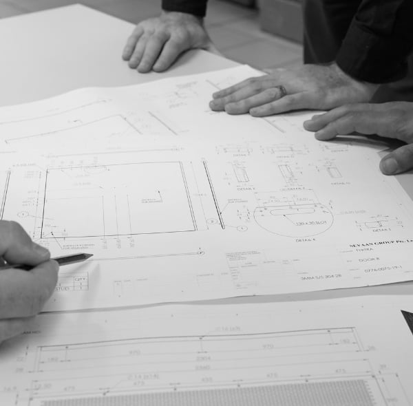 Hands on the table and a project plan