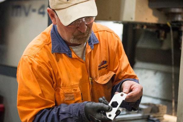 Man holiding a piece of metal