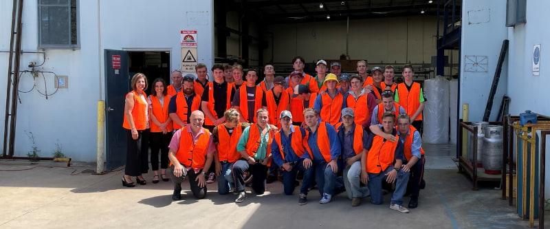 A group of people wearing orange vest