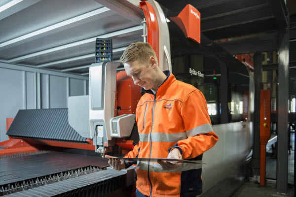 Man checking a metal from the machine