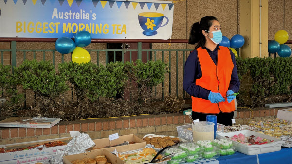 Woman wearing a face mask ready to assist in serving the food