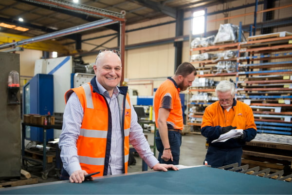 Three men working at the warehouse
